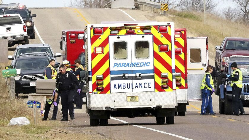 Emergency medical personnel gather at the scene of a hit-and-run accident Saturday, Nov. 3, 2018, in