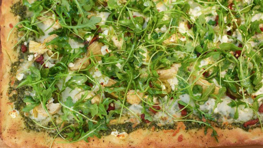 Eddie Jackson's Pesto Pizza with Feta and Artichokes.