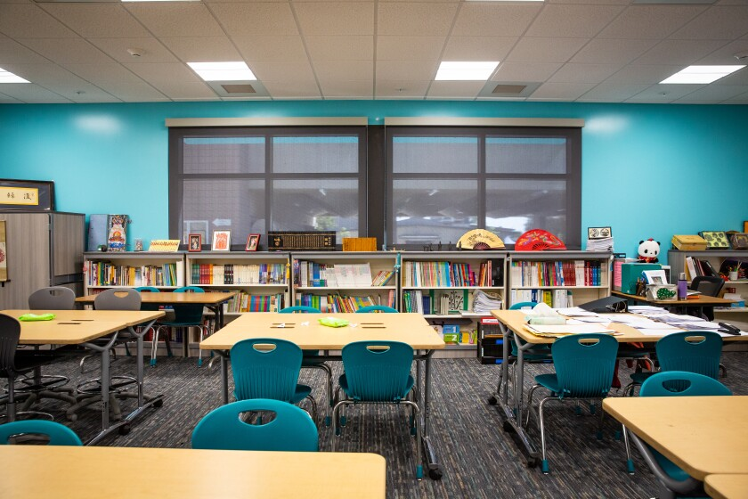 The new classrooms at Pacific Beach Middle School provide enough space for Mandarin teacher Yan Yan's extensive library.