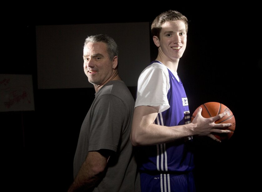 T.J. Leaf (right) is a 6-9 basketball player for Foothills Christian High School. Brad Leaf (left) is his coach. The sophomore is averaging 26.6 points and 11.9 rebounds a game. Earnie Grafton • U-T