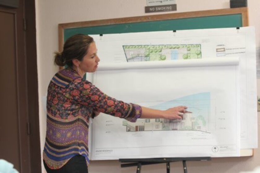 Camilla van Bommel of Island Architects reviews plans for a home rebuild at 1253 Muirlands Vista Way that were well-received during the DPR's Aug. 19 meeting.