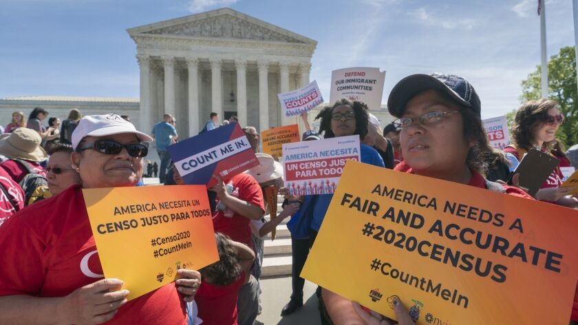 Immigration activists rally outside the Supreme Court as the justices hear arguments over the Trump administration's plan to ask about citizenship on the 2020 census on April 23.