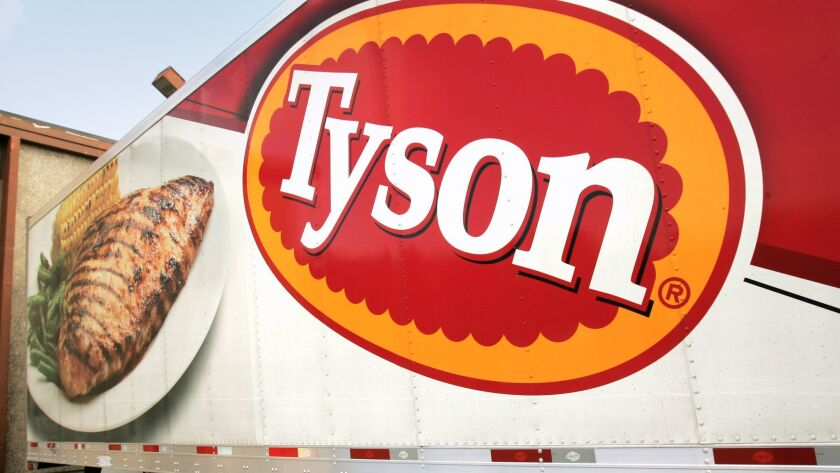 In this Oct. 28, 2009, file photo, a Tyson Foods, Inc., truck is parked at a food warehouse in Little Rock, Ark. Tyson Foods is among poultry producers recently sued by Winn-Dixie, alleging a widespread industry price-fixing scheme.