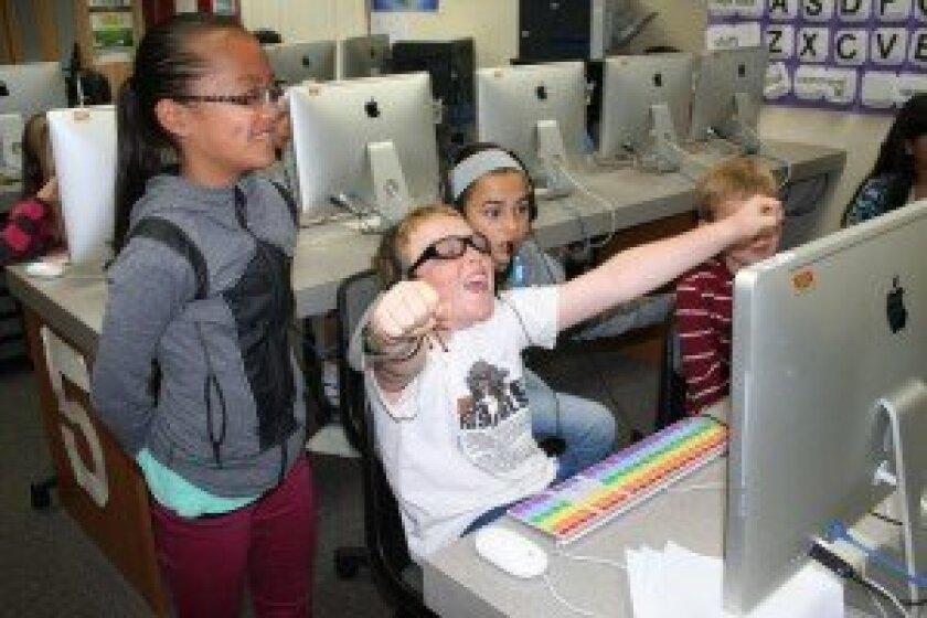 Torrey Hills fifth grader Tyler celebrates making a coding breakthrough. Courtesy photo