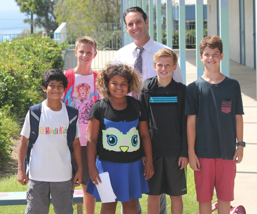 Muirlands Middle School Principal Harlan Klein with students (from left) Dhruv Banerjee, Gyusz Kangiszer, Olivia Lakin, Finn Rice and Lucas Chamberlin.