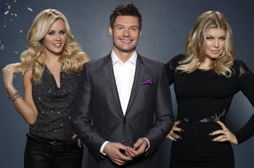 "Jenny McCarthy, left, Ryan Seacrest and Fergie host ""Dick Clark's Primetime New Year's Rockin' Eve With Ryan Seacrest"" on ABC."