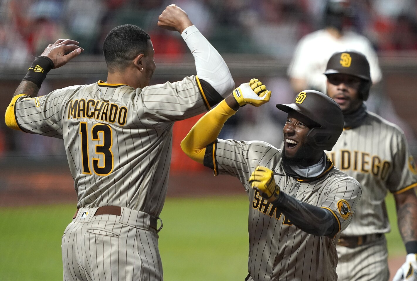 SAN FRANCISCO, CALIFORNIA - JULY 30: Jurickson Profar #10 and Manny Machado #13 of the San Diego Padres celebrates after Profar's two-run home run against the San Francisco Giants in the top of the sixth inning at Oracle Park on July 30, 2020 in San Francisco, California. (Photo by Thearon W. Henderson/Getty Images)
