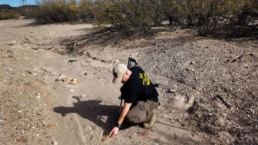 U.S. Customs and Border Protection Agent Aaron Bonsell checked signs of smuggling activity near the Rio Grande river in the Big Bend area last week: footprints with bits of carpet embedded, which smugglers use to hide their tracks.