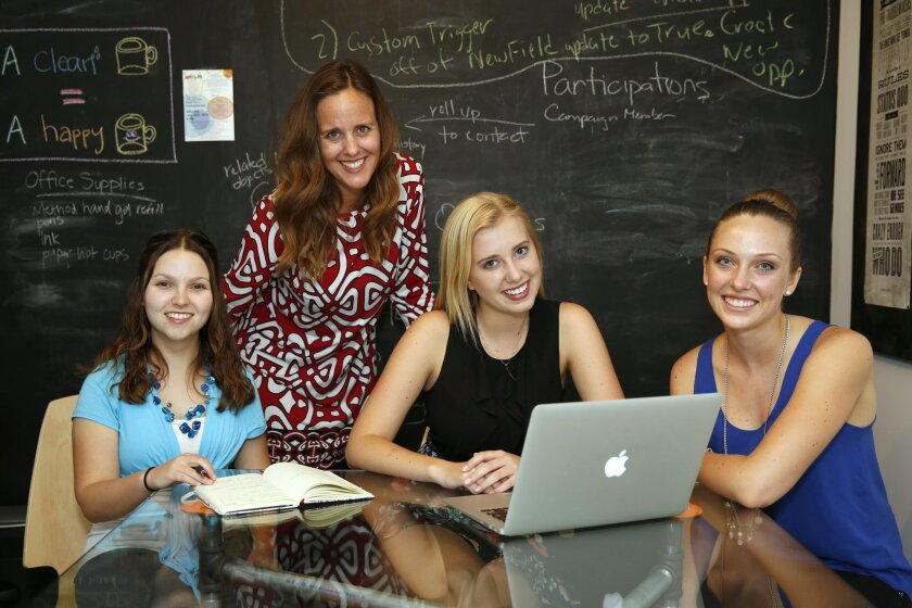WIT founder and director Sarah Hernholm, second from left, with recent Francis Parker School graduates Elisa Greenberg, left, Sophie Woods and Christina Clark. WIT, short for Whatever It Takes, provides a college-level course for high school students where they learn entrepreneurship and leadership skills while designing, launching and growing social-impact projects.