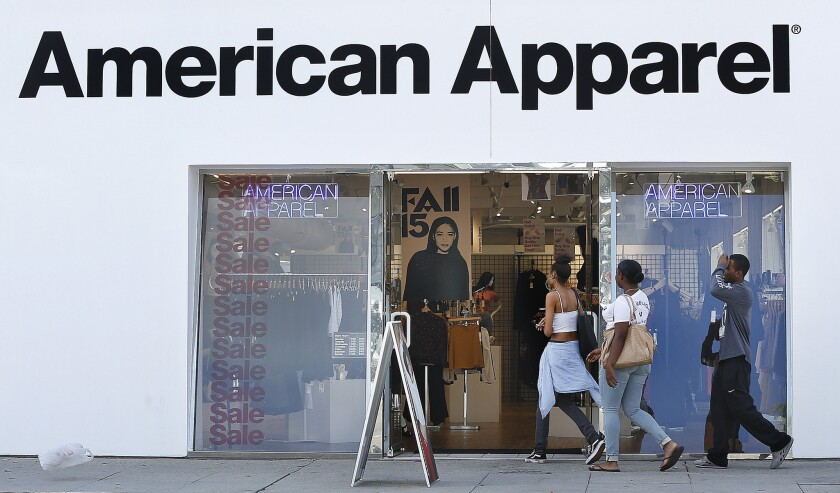 Customers make their way into an American Apparel store on Melrose Avenue in Los Angeles in October 2015.