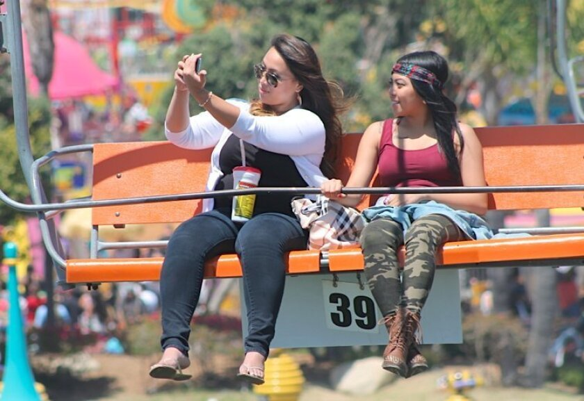 The clouds disappeared early Sunday at the San Diego County Fair, making for warm temperatures and a crowded midway.