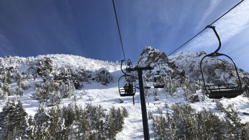 Skiers travel up a lift at Mammoth Mountain ski resort in Mammoth Lakes on Dec. 7.