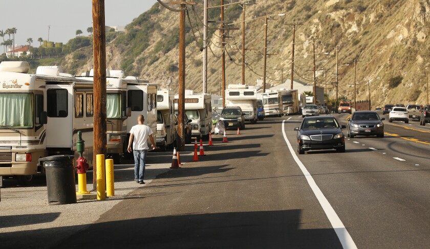 RVs and other vehicles in which people are living fill a stretch of the shoulder of  Pacific Coast Highway at Las Tunas Beach in Malibu in January.