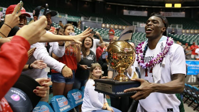 Zylan Cheatham shows fans the championship trophy after the Aztecs won the Diamond Head Classic at the Stan Sheriff Center in Honolulu. Cheatham, the tournament's MVP, is an emerging leader as San Diego State prepares for the Mountain West Conference season.