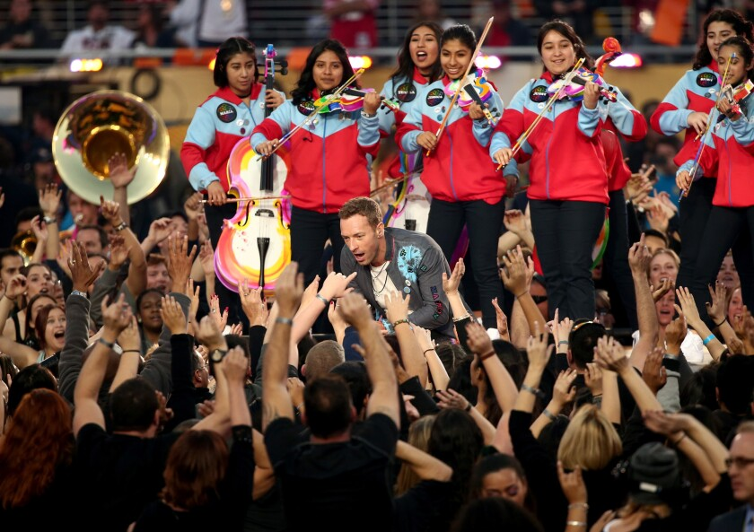 Members of Youth Orchestra Los Angeles back Chris Martin of Coldplay during the Super Bowl halftime show Sunday at Levi's Stadium in Santa Clara.