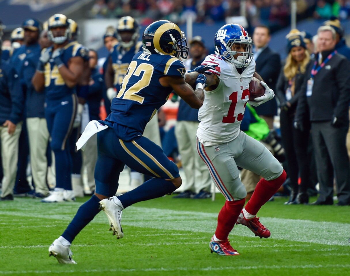 Oct 23, 2016; London, ENG; Wide receiver Odell Beckham (13) of the New York Giants runs with the ball against the Los Angeles Rams during the third quarter of the game between the Los Angeles Rams and the New York Giants at Twickenham Stadium. Mandatory Credit: Steve Flynn-USA TODAY Sports ** Usable by SD ONLY **
