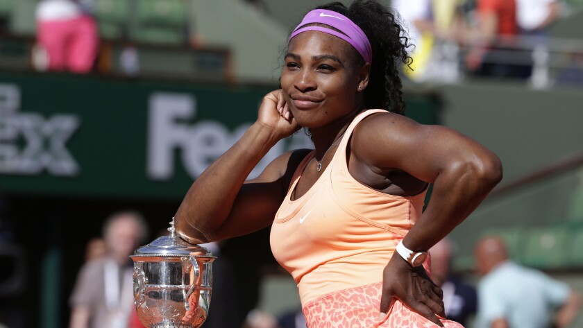 Serena Williams strikes a pose with the championship trophy after defeating Lucie Safarova in the French Open final on June 6, 2015.
