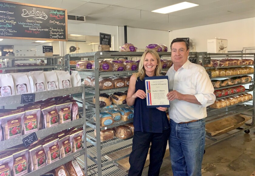 Supervisor Joel Anderson honors Lydia Bilic of Dudley's Bakery for dedication to the community during the pandemic.