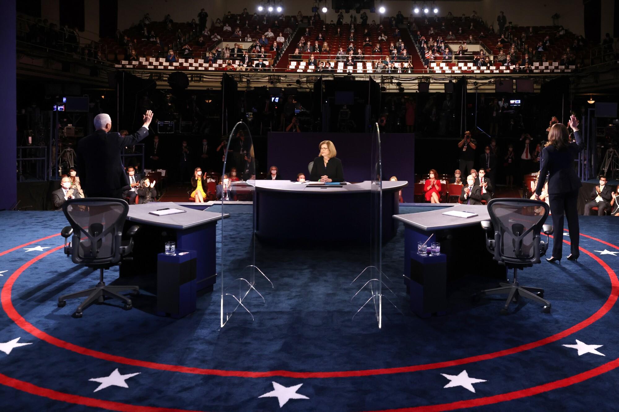 Mike Pence, Kamala Harris and Susan Page at the vice presidential debate in Salt Lake City.