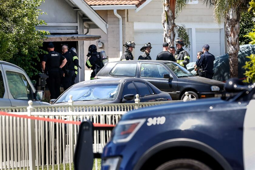 """Emergency responders respond to a fire at the house of the suspect of a shooting, after nine people were reported dead including the shooter on May 26, 2021 at the San Jose Railyard in San Jose, California. - Multiple people were killed in a shooting Wednesday at a rail yard in California's Bay Area, police said, the latest instance of deadly gun violence in the United States. """"I can't confirm the exact number of injuries and fatalities. But I will tell you that there are multiple injuries and multiple fatalities in this case,"""" Russell Davis, a Santa Clara County Sheriff's deputy, told journalists, adding that the gunman was dead. (Photo by Amy Osborne / AFP) (Photo by AMY OSBORNE/AFP via Getty Images)"""