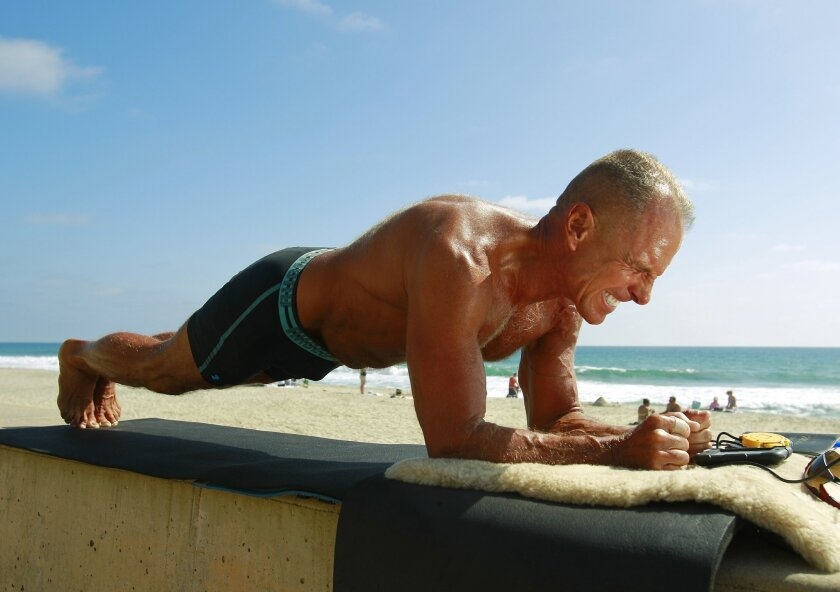 George Hood, who will attempt to break the world record for the longest plank on Saturday, practices his pose on Thursday in Carlsbad.
