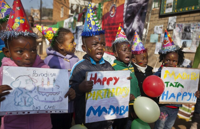 """File-This July 18, 2013, file photo shows a group of kindergarten children singing Happy Birthday to Nelson Mandela outside the Mediclinic Heart Hospital in Pretoria, South Africa. The music publishing company that has been collecting royalties on the song """"Happy Birthday To You"""" for years does not hold a valid copyright on the lyrics to the tune that is one of the mostly widely sung in the world, a federal judge ruled Tuesday, Sept. 22, 2015. (AP Photo/Ben Curtis, File)"""