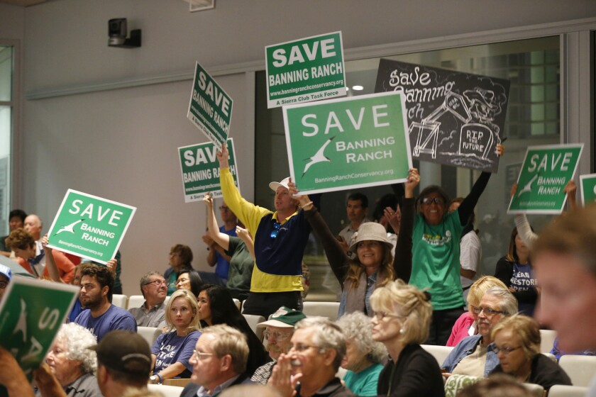 Opponents of the Newport Banning Ranch project celebrate after the Coastal Commission vote.