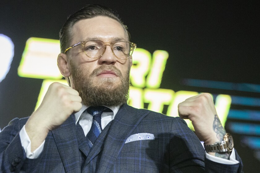 Conor McGregor poses during a news conference Thursday in Moscow.
