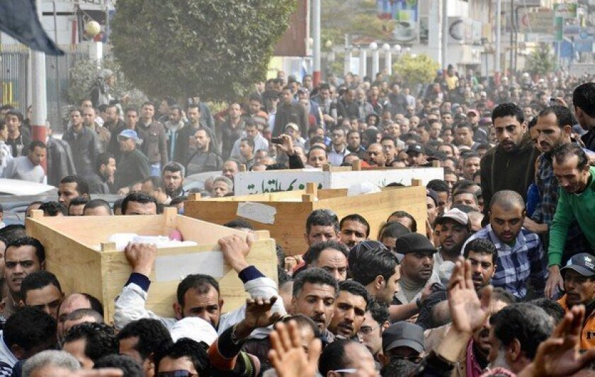 Egyptians march in a funeral procession in Port Said, Egypt.