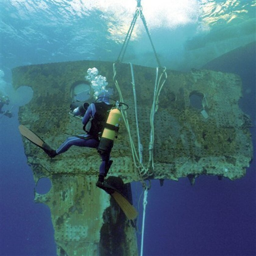This 1998 image provided by RMS Titanic, Inc., shows a 17-ton portion of the hull of the RMS Titanic as it is lifted to the surface during an expedition to the site of the tradegy. The piece along with 5,000 other artifacts will be auctioned as a single collection on April 11, 2012 100 years after the sinking of the ship. (AP Photo/RMS Titanic, Inc.)