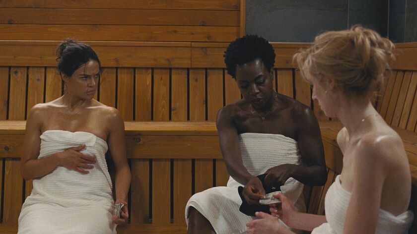 "Michelle Rodriguez, Viola Davis and Elizabeth Debicki in the movie ""Widows."""