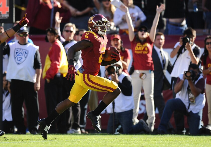 USC cornerback Adoree' Jackson returns a punt 42 yards for a touchdown against UCLA in the first half.