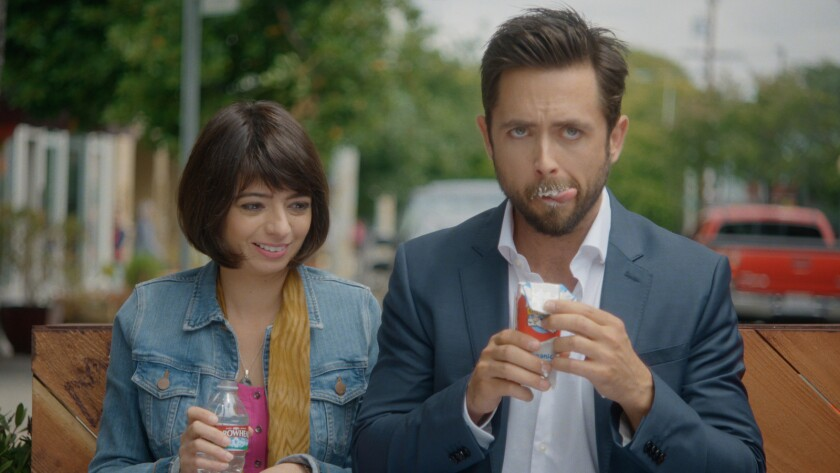 """Kate Micucci and Justin Chatwin in the movie """"Unleashed."""""""