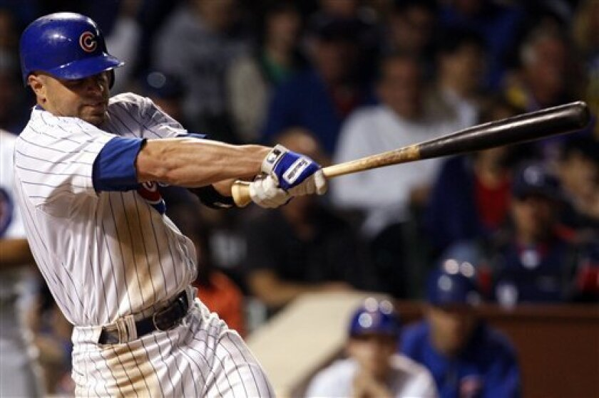 Chicago Cubs' Reed Johnson hits a two-run double against the Los Angeles Dodgers during the sixth inning of a baseball game on Sunday, May 31, 2009  in Chicago. (AP Photo/Nam Y. Huh)