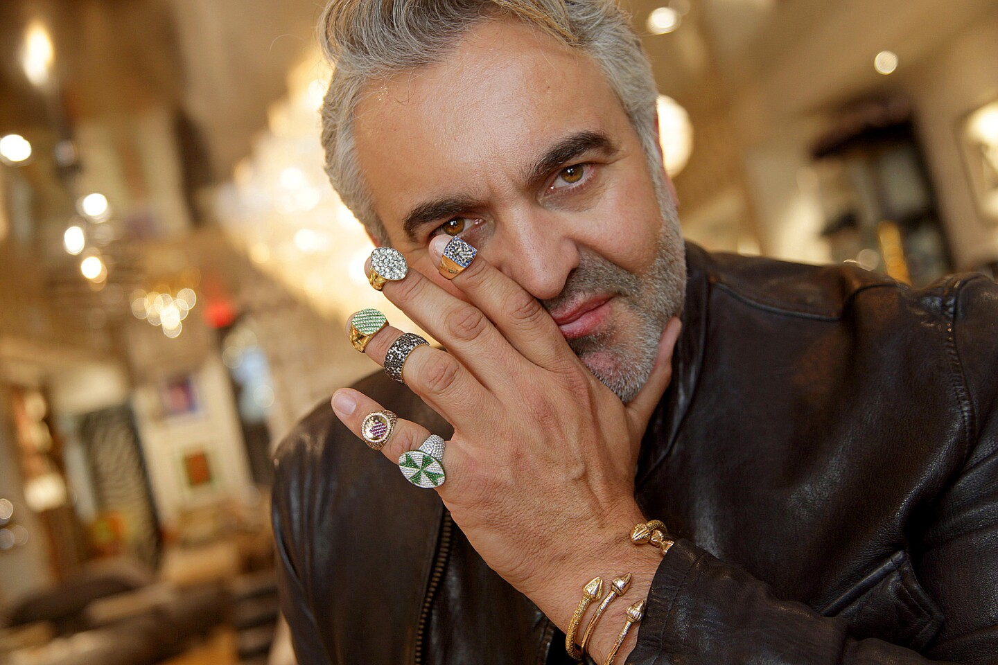 "L.A.-based interior designer Martyn Lawrence Bullard is branching out into fine jewelry. ""I like bling-bling,"" says the author and TV personality, who shows off an assortment of unisex rings he designed."