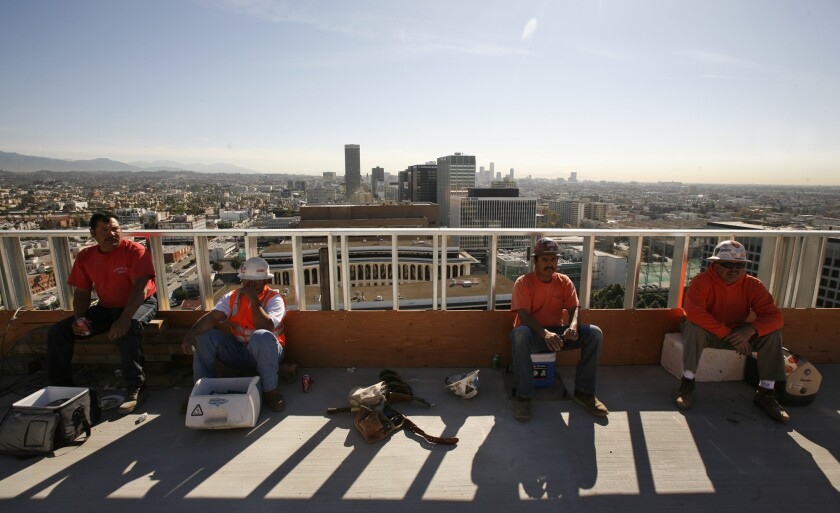A study found that U.S. cities could warm an additional 3.6 degrees by 2100 unless they slow their expansion, paint roofs white or plant rooftop vegetation. Above, construction workers take a break on a Los Angeles rooftop.