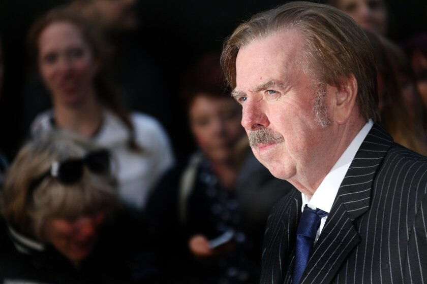 """FILE - In this Oct. 10, 2014 file photo, actor Timothy Spall arrives for the London Film Festival premiere of """"Mr Turner"""" at the Odeon West End in central London. How do you play an artistic genius? For veteran British actor Spall, the first step was obvious: He had to learn to paint and draw, and"""
