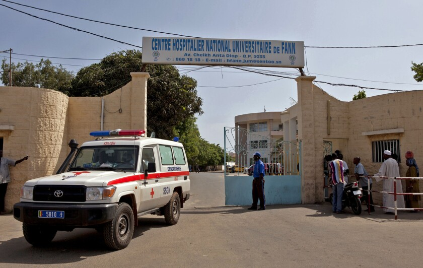 A ambulance leaves the hospital were a man is being treated for Ebola in Dakar, Senegal.