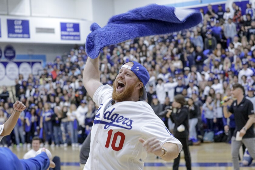 Dodgers third baseman Justin Turner participates in a game during a pep rally at Saugus High School in Santa Clarita on Friday.