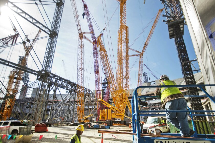 FILE - In this May 16, 2016, file photo, cranes sit inside the Atlanta Falcons new NFL football stadium currently under construction in Atlanta. The NFL awarded Super Bowls to Atlanta (2019), Miami (2020) and Los Angeles (2021), three cities that made significant financial investments in new stadiums or recently upgraded an existing one, Tuesday, May 24, 2016, at the NFL owners meetings. . (AP Photo/David Goldman, File)