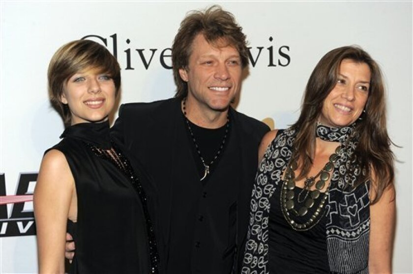 Jon Bon Jovi, center, with daughter Stephanie Rose Bon Jovi, left, and wife Dorothea Rose Hurley arrive at the annual Pre-GRAMMY Gala presented by The Recording Academy and Clive Davis on Saturday, Jan. 30, 2010 at The Beverly Hilton Hotel in Beverly, Hills, California. (AP Photo/Chris Pizzello)