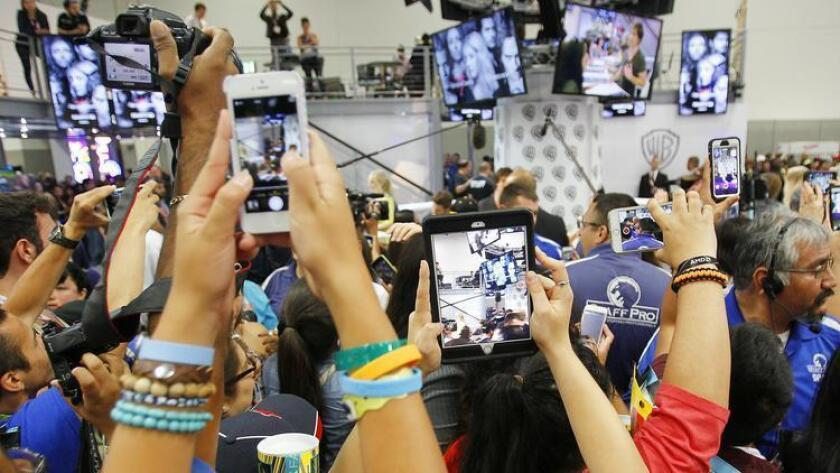Fans try to get a photo of the cast of The Vampire Diaries at Comic-Con. (K.C. Alfred)