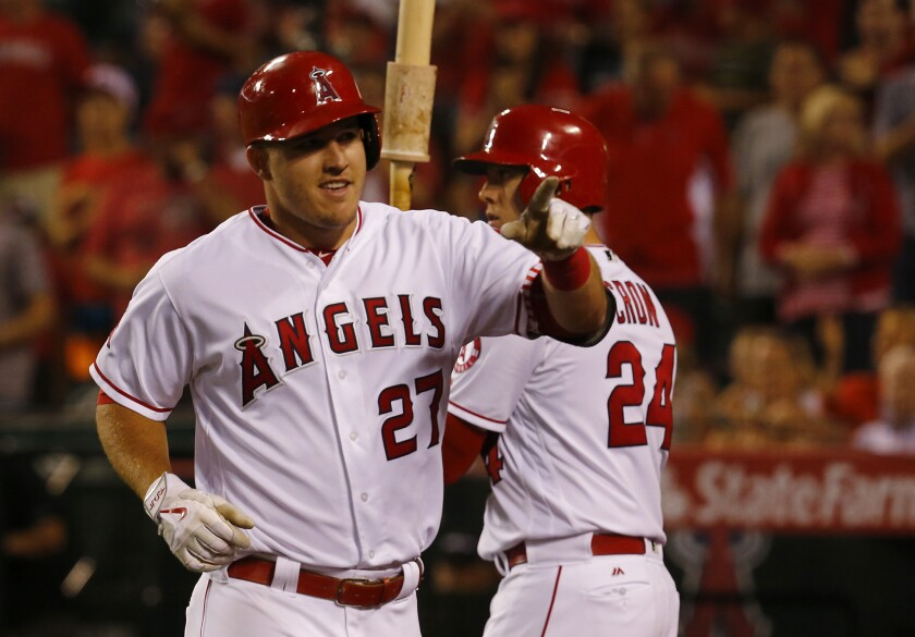 Angels center fielder Mike Trout celebrates after hitting a solo home run against the Astros on June 27 at Angels Stadium.