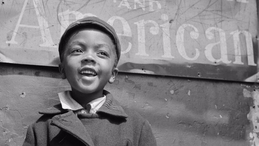 """A Harlem newsboy,"" 1943. New York, New York."