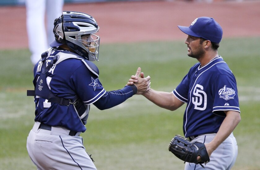 Padres catcher Rene Rivera, left, congratulates closer Huston Street on Wednesday after a 2-1 win over the Cleveland Indians.