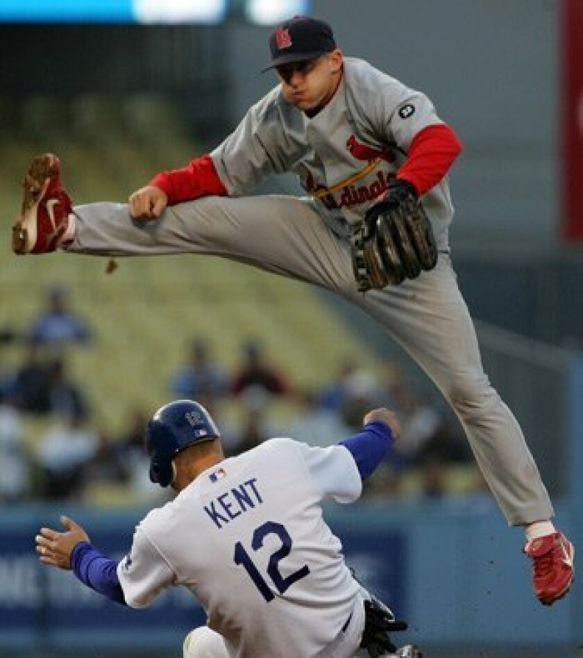 David Eckstein jumps over the Dodgers' Jeff Kent as a shortstop for the St. Louis Cardinals in 2007. Eckstein was signed by the Padres on Thursday to play second base.