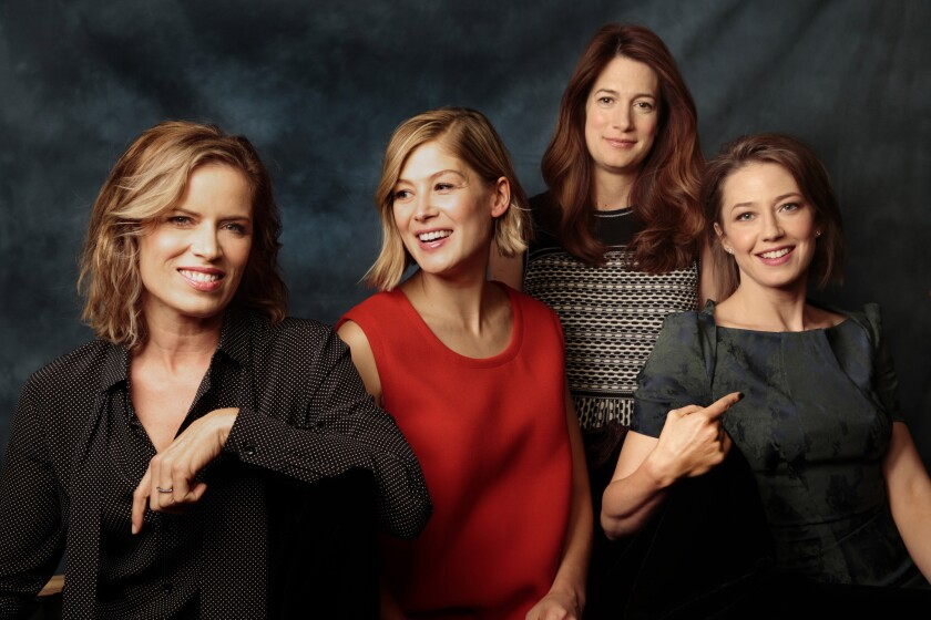 """""""To me, so much of the movie is about marriage, but it's also about gender,"""" says writer Gillian Flynn, second from right, of """"Gone Girl."""" The cast features, from left, Kim Dickens as Det. Boney, Rosamund Pike as the missing Amy and Carrie Coon as Nick's twin sister, Go."""