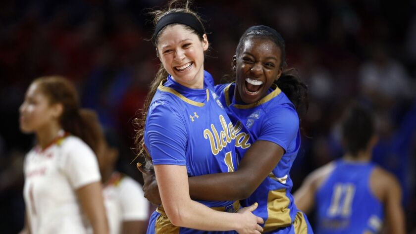 UCLA guard Lindsey Corsaro, left, and forward Michaela Onyenwere celebrate after a second-round game against Maryland in the NCAA women's tournament on Monday in College Park, Md. UCLA won 85-80.