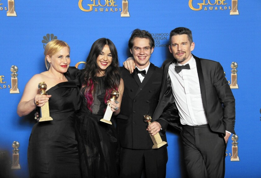 """""""Boyhood"""" cast Patricia Arquette, left, Lorelei Linklater, Ellar Coltrane and Ethan Hawke celebrate the film's win. Arquette also won for supporting actress."""