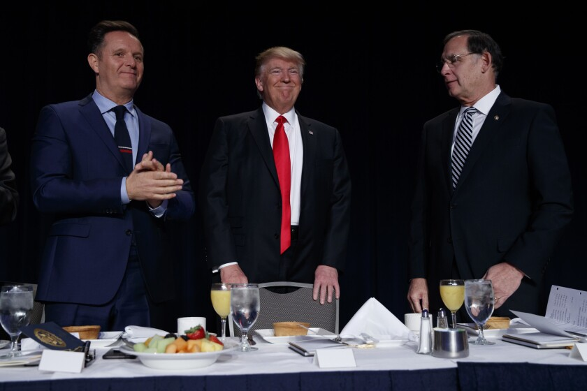 Television producer Mark Burnett, left, and Sen. John Boozman (R-Ark.) with President Trump at the National Prayer Breakfast on Thursday in Washington.